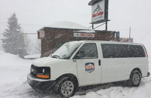 Alta Shuttle in Front of Alta Lodge on a Snowy Day
