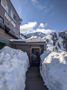 Alta Lodge Entryway with Snow. Mt. Baldy in the background.
